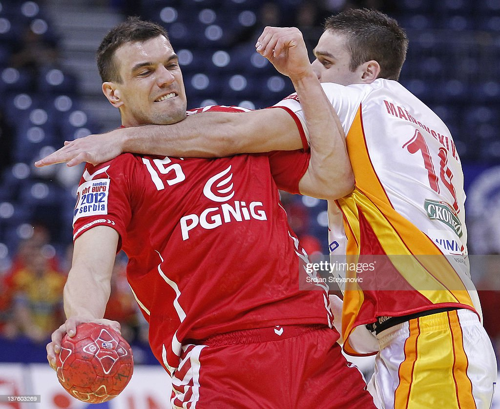 Mihal Jurecki (L) of Poland competes with Velko Markoski of Macedonia, during the Men's European Handball Championship 2012 second round group one, match between Poland and Macedonia, at Arena Hall on January 23, 2012 in Belgrade, Serbia.