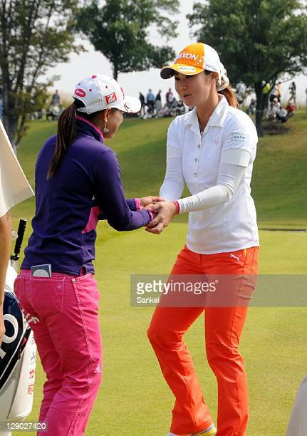Miho Koga and Sakura Yokomine praise each otherfs performances during the final round of the Sankyo Ladies Open at Yoshii Country Club on October 9...