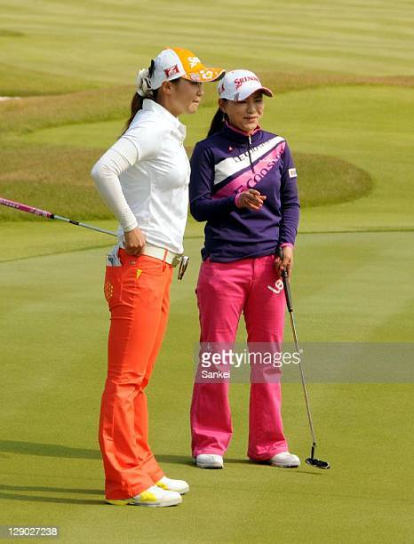 Miho Koga discusses with Sakura Yokomine on the 18th hole during the final round of the Sankyo Ladies Open at Yoshii Country Club on October 9 2011...