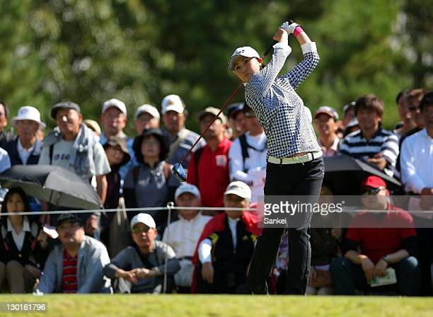 Miho Koga hits a shot during the first round of the Masters GC Ladies at Masters Golf Club on October 21 2011 in Miki Hyogo Japan