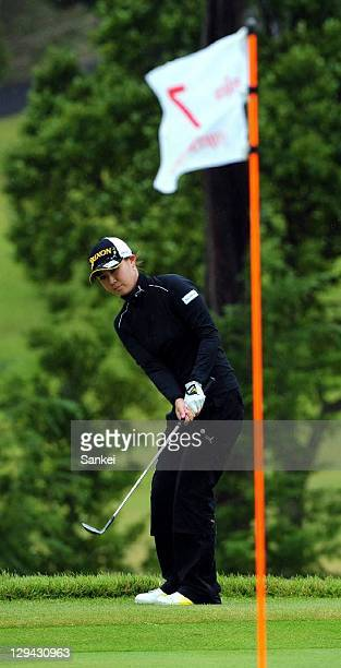 Miho Koga hits an approach shot on the 7th hole during the second round of the Fujitsu Ladies at Tokyu Seven Hundred Club on October 15 2011 in Chiba...