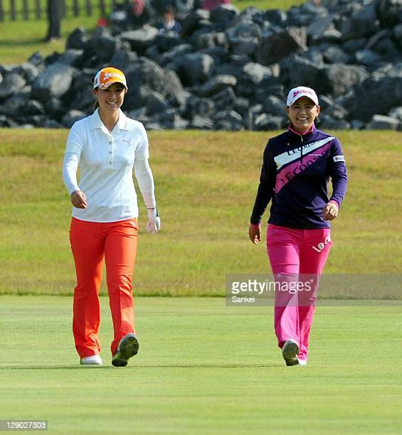 Miho Koga walks with Sakura Yokomine during the final round of the Sankyo Ladies Open at Yoshii Country Club on October 9 2011 in Takasaki Gunma Japan