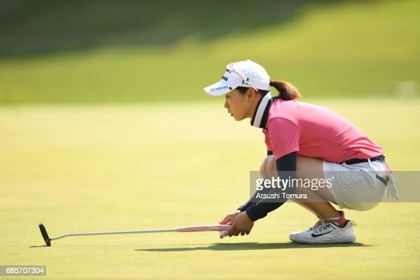 Miho Mori of Japan lines up her putt on the 1st hole during the final round of the Twin Fields Ladies Tournament at the Golf Club Twin Fields on May...