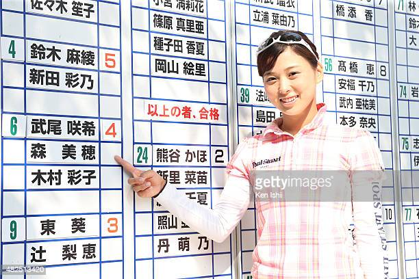 Miho Mori of Japan points her name in front of a result board after the final round of the LPGA Pro Test QT at the Kodama Golf Club on July 31 2015...