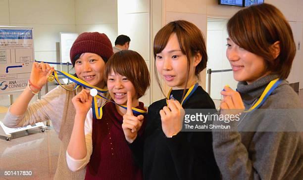 Miho Takagi Nana Takagi Misaki Oshigiri and Ayaka Kikuchi of speed skating Japan Women's Team Pursuit members pose for photographs with their medals...