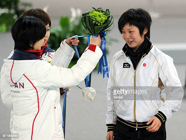 Miho Takagi not competed in any of Japan's team pursuit races is being worn the silver medal by Maki Tabata after the medal ceremony of the ladies'...