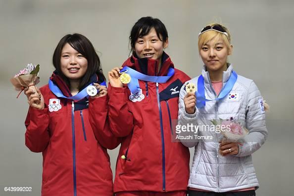Miho Takagi of Japan Ayano Sato of Japan and BoReum Kim of South Korea pose on the podium during award ceremony for the speed skating ladies mass...