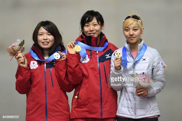 Miho Takagi of Japan Ayano Sato of Japan and BoReum Kim of South Korea pose on the podium during award ceremony for the speed skating ladies mass...