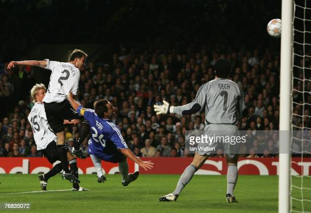 Miika Koppinen of Rosenborg beats John Terry of Chelsea to shoot past Petr Cech to score their first goal during the UEFA Champions League Group B...