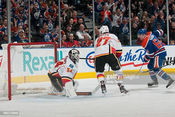 Miikka Kiprusoff of the Calgary Flames allows a third straight goal in the first period in a game against the Edmonton Oilers on April 1 2013 at...
