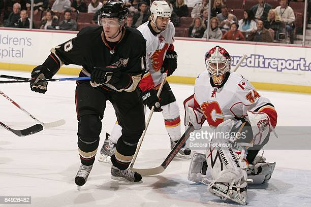 Miikka Kiprusoff of the Calgary Flames defends in the crease against Corey Perry of the Anaheim Ducks during the game on February 11 2009 at Honda...
