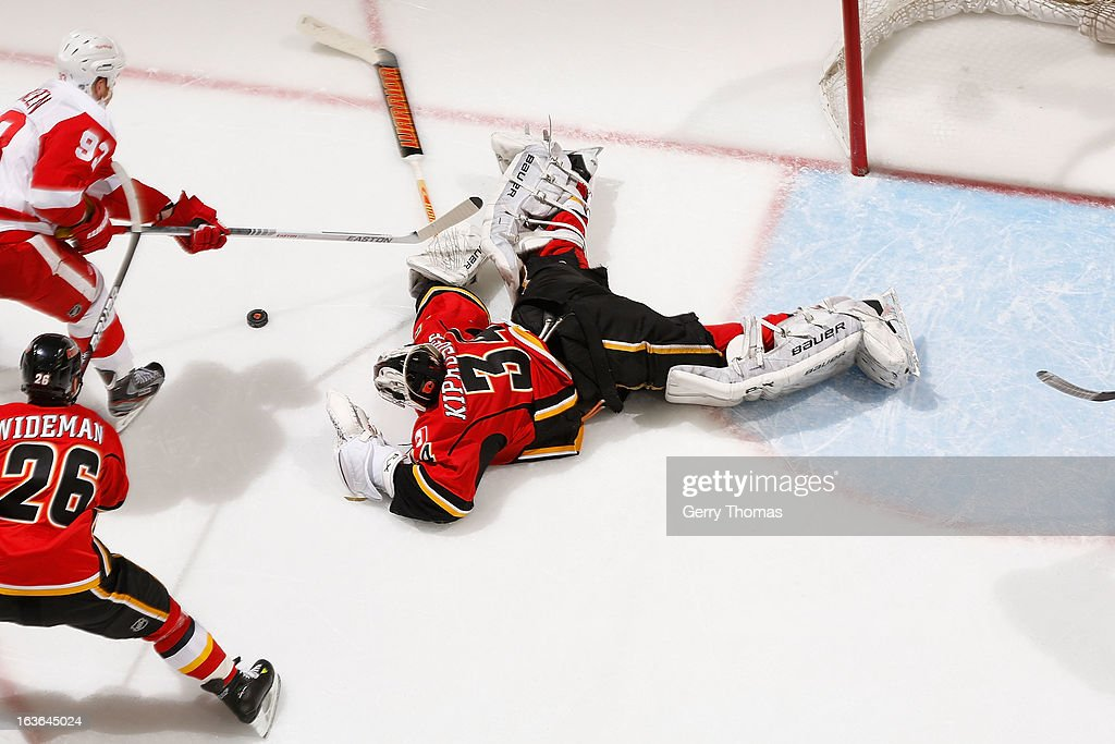 <a gi-track='captionPersonalityLinkClicked' href=/galleries/search?phrase=Miikka+Kiprusoff&family=editorial&specificpeople=171703 ng-click='$event.stopPropagation()'>Miikka Kiprusoff</a> #34 of the Calgary Flames makes a save against <a gi-track='captionPersonalityLinkClicked' href=/galleries/search?phrase=Johan+Franzen&family=editorial&specificpeople=624356 ng-click='$event.stopPropagation()'>Johan Franzen</a> #93 of the Detroit Red Wings on March 13, 2013 at the Scotiabank Saddledome in Calgary, Alberta, Canada.