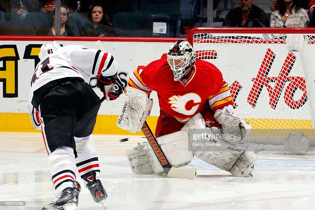 <a gi-track='captionPersonalityLinkClicked' href=/galleries/search?phrase=Miikka+Kiprusoff&family=editorial&specificpeople=171703 ng-click='$event.stopPropagation()'>Miikka Kiprusoff</a> #34 of the Calgary Flames makes a save against <a gi-track='captionPersonalityLinkClicked' href=/galleries/search?phrase=Marian+Hossa&family=editorial&specificpeople=202233 ng-click='$event.stopPropagation()'>Marian Hossa</a> #81 of the Chicago Blackhawks on February 2, 2013 at the Scotiabank Saddledome in Calgary, Alberta, Canada.