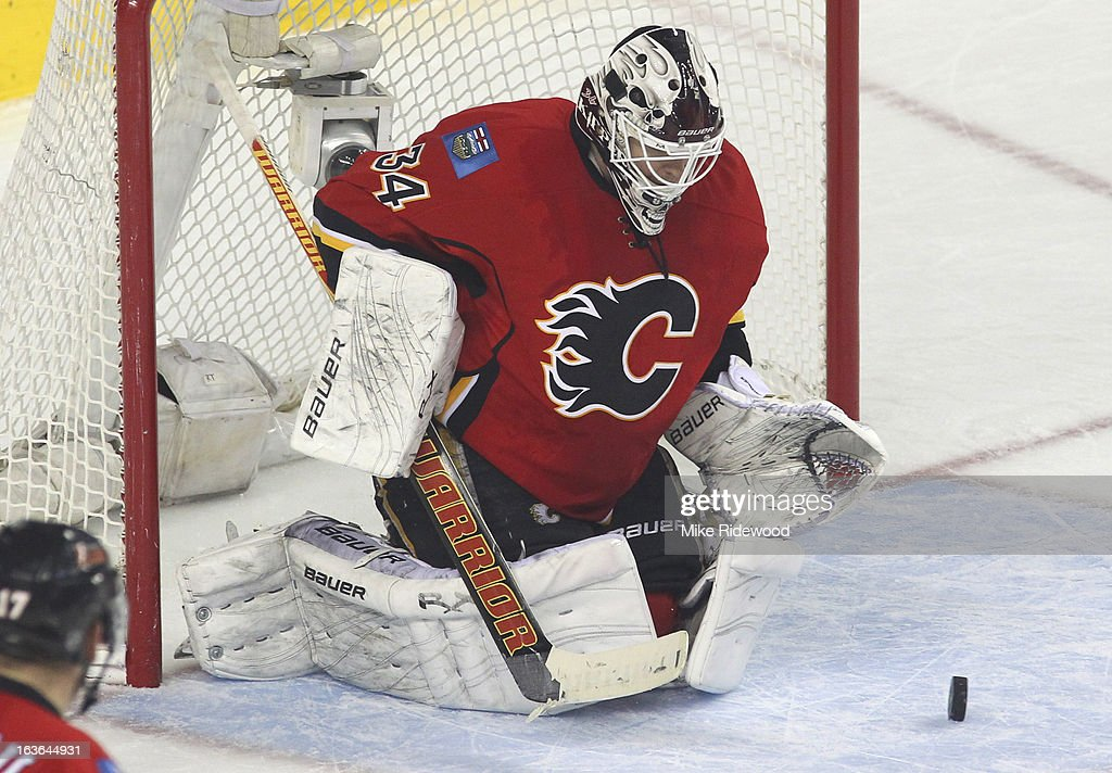 <a gi-track='captionPersonalityLinkClicked' href=/galleries/search?phrase=Miikka+Kiprusoff&family=editorial&specificpeople=171703 ng-click='$event.stopPropagation()'>Miikka Kiprusoff</a> #34 of the Calgary Flames makes a save against the Detroit Red Wings during third period NHL action on March 13, 2013 at the Scotiabank Saddledome in Calgary, Alberta, Canada. Calgary Flames defeated the Detroit Red Wings 5 - 2.