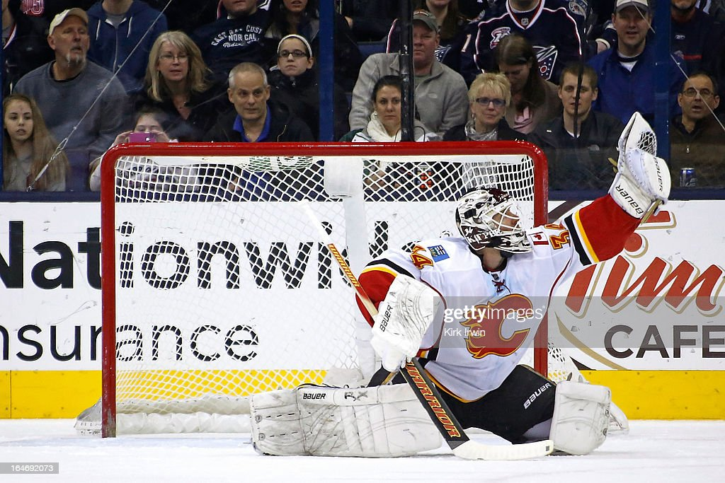 Miikka Kiprusoff #34 of the Calgary Flames makes a save during the game against the Columbus Blue Jackets on March 22, 2013 at Nationwide Arena in Columbus, Ohio.