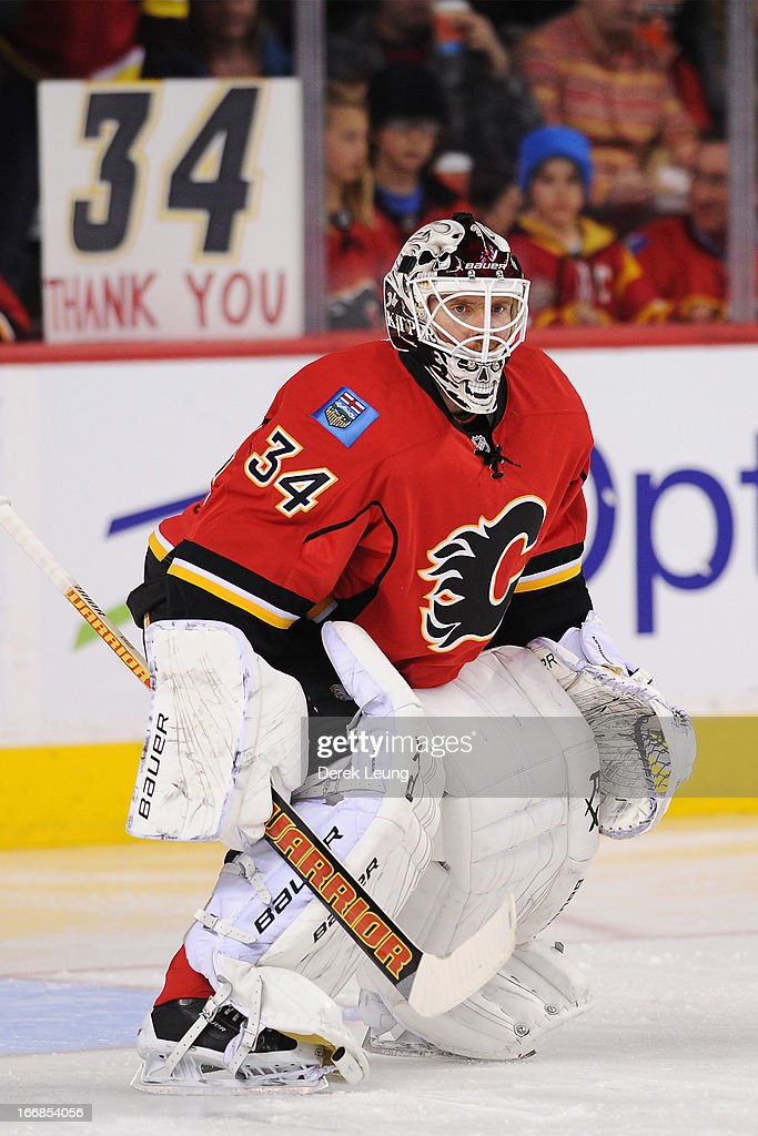 <a gi-track='captionPersonalityLinkClicked' href=/galleries/search?phrase=Miikka+Kiprusoff&family=editorial&specificpeople=171703 ng-click='$event.stopPropagation()'>Miikka Kiprusoff</a> #34 of the Calgary Flames warms-up before an NHL game against the Detroit Red Wings at Scotiabank Saddledome on April 17, 2013 in Calgary, Alberta, Canada. <a gi-track='captionPersonalityLinkClicked' href=/galleries/search?phrase=Miikka+Kiprusoff&family=editorial&specificpeople=171703 ng-click='$event.stopPropagation()'>Miikka Kiprusoff</a> is playing in what could be his final game.