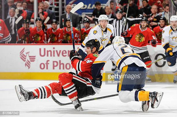 Miikka Salomaki of the Nashville Predators pushes into Richard Panik of the Chicago Blackhawks during the NHL game at the United Center on February...