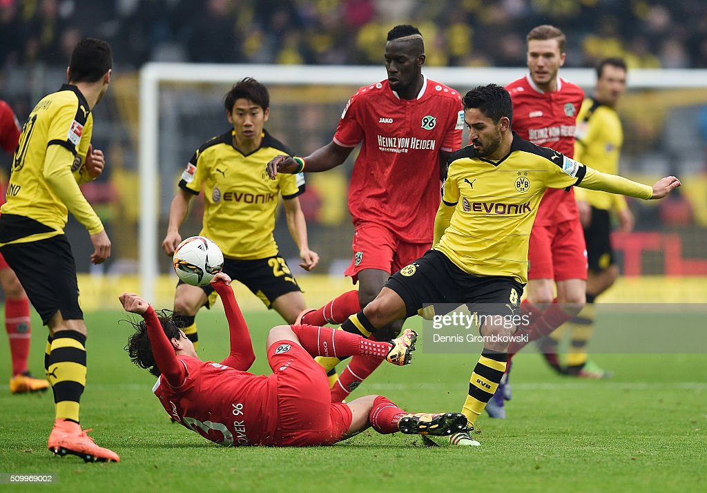 Miiko Albornoz Inola of Hannover 96 challenges Ilkay Guendogan of Borussia Dortmund during the Bundesliga match between Borussia Dortmund and Hannover 96 at Signal Iduna Park on February 13, 2016 in Dortmund, Germany.