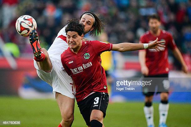 Miiko Albornoz of Hannover is challenged by Martin Harnik of Stuttgartduring to the Bundesliga match between Hannover 96 and VfB Stuttgart at...