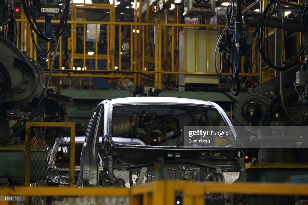 Miinicars, which will be sold as the Nissan DAYZ by Nissan Motor Co. and Mitsubishi eK Wagon by Mitsubishi Motors Corp., go through the welding section on the production line of the Mitsubishi Motors Mizushima plant in Kurashiki City, Okayama Prefecture, Japan, on Monday, May 20, 2013. Nissan will start selling the first minicar it jointly developed with Mitsubishi Motors in Japan next month amid increasing demand from the nation's consumers for smaller and cheaper vehicles. Photographer: Tomohiro Ohsumi/Bloomberg via Getty Images