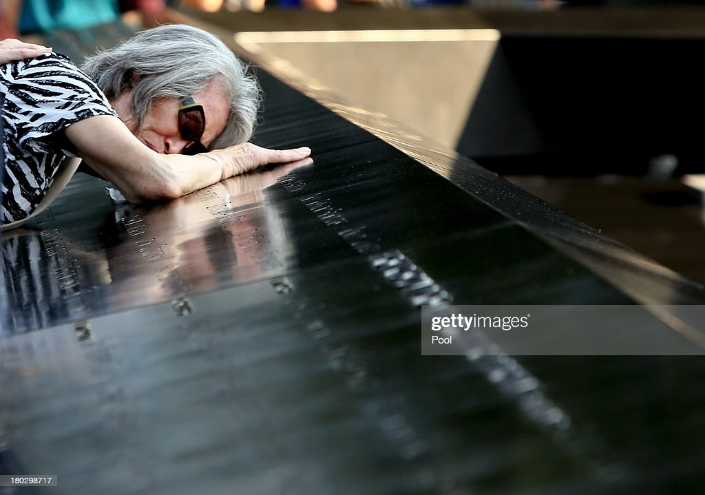 Mija Quigley of Princeton Junction, NJ embraces the name of her son Patrick Quigley who died aboard Flight 175 during ceremonies for the twelfth anniversary of the terrorist attacks on lower Manhattan at the World Trade Center site on September 11, 2013 in New York City. The nation is commemorating the anniversary of the 2001 attacks which resulted in the deaths of nearly 3,000 people after two hijacked planes crashed into the World Trade Center, one into the Pentagon in Arlington, Virginia and one crash landed in Shanksville, Pennsylvania. Following the attacks in New York, the former location of the Twin Towers has been turned into the National September 11 Memorial & Museum.