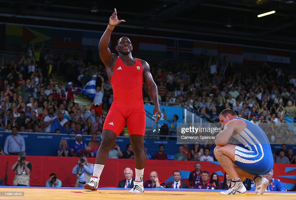 <a gi-track='captionPersonalityLinkClicked' href=/galleries/search?phrase=Mijain+Lopez&family=editorial&specificpeople=2217968 ng-click='$event.stopPropagation()'>Mijain Lopez</a> Nunez of Cuba celebrates beating <a gi-track='captionPersonalityLinkClicked' href=/galleries/search?phrase=Heiki+Nabi&family=editorial&specificpeople=9617990 ng-click='$event.stopPropagation()'>Heiki Nabi</a> of Estonia in their Men's Greco-Roman 120 kg Wrestling Gold Medal bout on Day 10 of the London 2012 Olympic Games at ExCeL on August 6, 2012 in London, England.