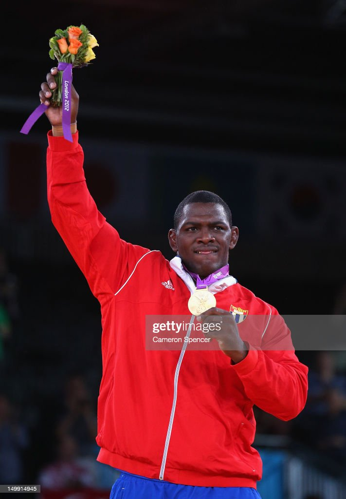 <a gi-track='captionPersonalityLinkClicked' href=/galleries/search?phrase=Mijain+Lopez&family=editorial&specificpeople=2217968 ng-click='$event.stopPropagation()'>Mijain Lopez</a> Nunez of Cuba celebrates with his Gold medal after beating Heiki Nabi of Estonia in their Men's Greco-Roman 120 kg Wrestling Gold Medal bout on Day 10 of the London 2012 Olympic Games at ExCeL on August 6, 2012 in London, England.