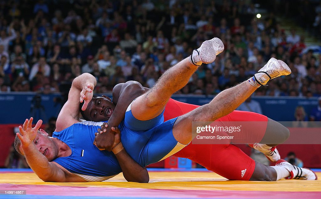 <a gi-track='captionPersonalityLinkClicked' href=/galleries/search?phrase=Mijain+Lopez&family=editorial&specificpeople=2217968 ng-click='$event.stopPropagation()'>Mijain Lopez</a> Nunez of Cuba competes with <a gi-track='captionPersonalityLinkClicked' href=/galleries/search?phrase=Heiki+Nabi&family=editorial&specificpeople=9617990 ng-click='$event.stopPropagation()'>Heiki Nabi</a> of Estonia (L) in their Men's Greco-Roman 120 kg Wrestling Gold Medal bout on Day 10 of the London 2012 Olympic Games at ExCeL on August 6, 2012 in London, England.