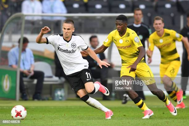 Mijat Gacinovic of Eintracht Frankfurt and Ousmane Dembele of Borussia Dortmund compete for the ball during the DFB Cup Final match between Eintracht...