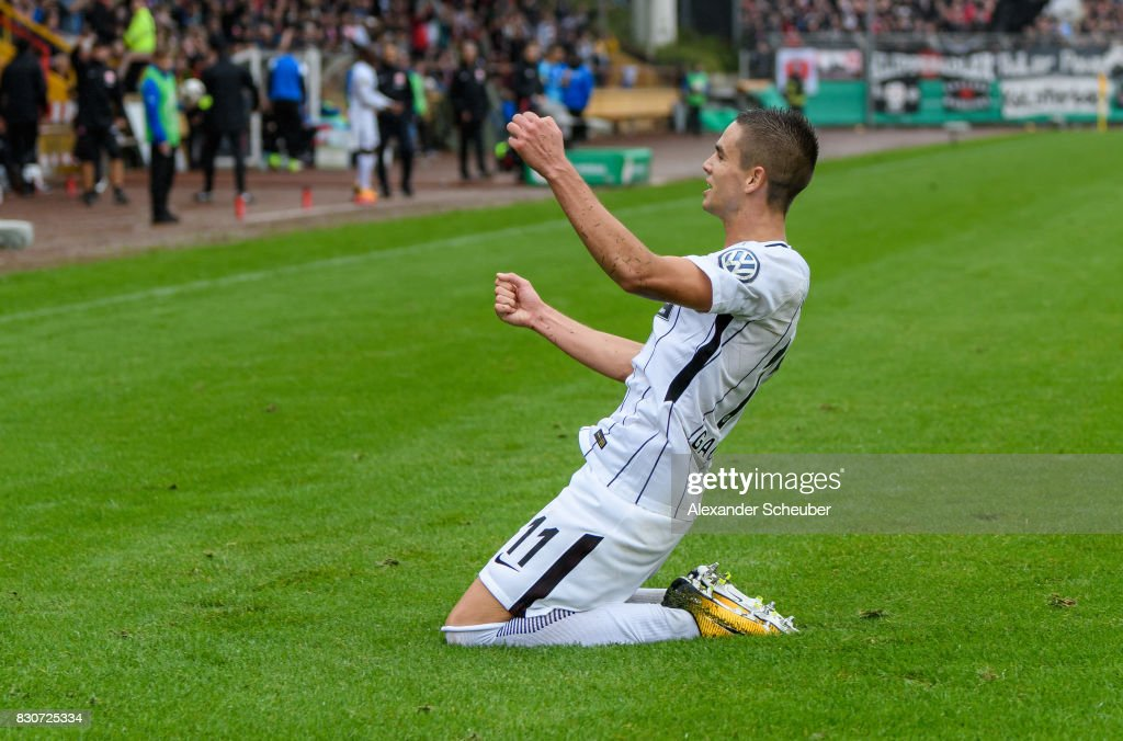 Mijat Gacinovic of Eintracht Frankfurt celebrates the second goal for his team during the DFB Cup match between TuS Erndtebrueck and Eintracht Frankfurt at Leimbachstadion on August 12, 2017 in Siegen, Germany.