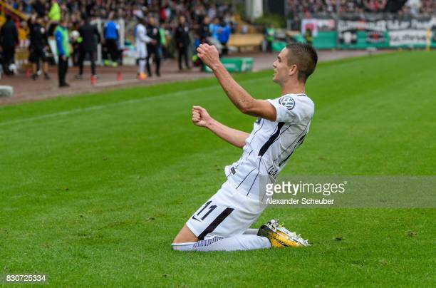 Mijat Gacinovic of Eintracht Frankfurt celebrates the second goal for his team during the DFB Cup match between TuS Erndtebrueck and Eintracht...