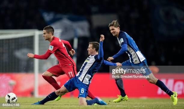 Mijat Gacinovic of Eintracht Frankfurt is challenged by Vladimir Darida of Hertha BSC and Niklas Stark of Hertha BSC during the Bundesliga match...