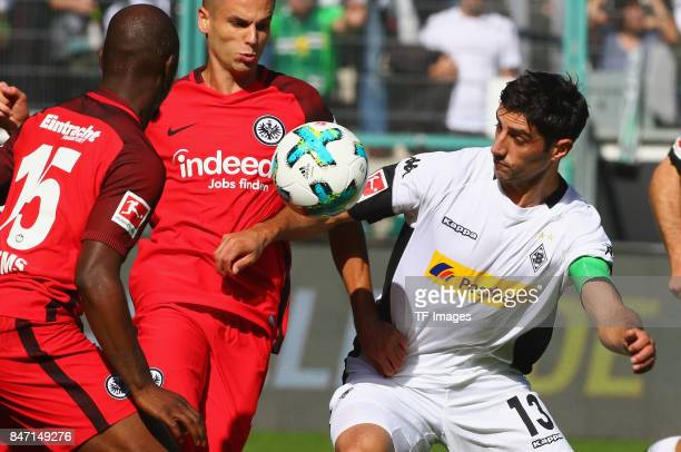 Mijat Gacinovic of Frankfurt and Lars Stindl of Moenchengladbach battle for the ball during the Bundesliga match between Borussia Moenchengladbach...
