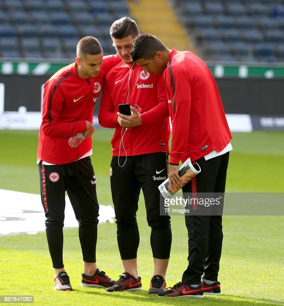 Mijat Gacinovic of Frankfurt and Luka Jovic of Frankfurt and Slobodan Medojevic of Frankfurt looks on during the Bundesliga match between Eintracht...