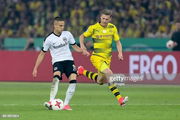 Mijat Gacinovic of Frankfurt and Lukasz Piszczek of Dortmund battle for the ball during the DFB Cup final match between Eintracht Frankfurt and...