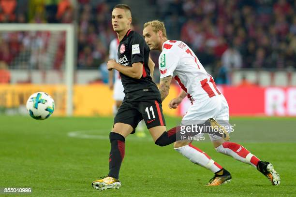 Mijat Gacinovic of Frankfurt and Marcel Risse of Koeln battle for the ball during the Bundesliga match between 1 FC Koeln and Eintracht Frankfurt at...
