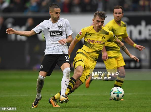 Mijat Gacinovic of Frankfurt and Maximilian Philipp of Dortmund compete for the ball during the Bundesliga match between Eintracht Frankfurt and...
