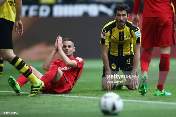 Mijat Gacinovic of Frankfurt and Nuri Sahin of Dortmund react during the Bundesliga match between Borussia Dortmund and Eintracht Frankfurt at Signal...