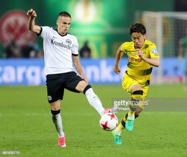 Mijat Gacinovic of Frankfurt and Shinji Kagawa of Dortmund battle for the ball during the DFB Cup final match between Eintracht Frankfurt and...