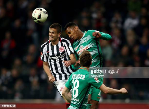 Mijat Gacinovic of Frankfurt and Theodor Gebre Selassie of Bremen battle for the ball during the Bundesliga match between Eintracht Frankfurt and...