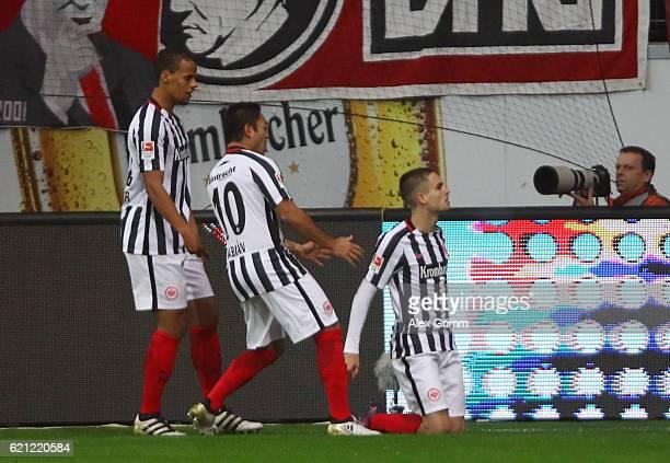 Mijat Gacinovic of Frankfurt celebrates his team's first goal with team mates Marco Fabian and Timothy Chandler during the Bundesliga match between...