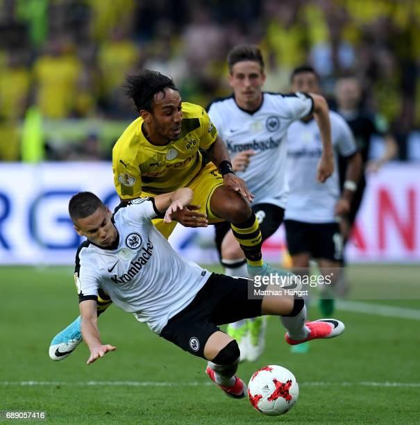 Mijat Gacinovic of Frankfurt challenges PierreEmerick Aubameyang of Dortmund during the DFB Cup Final 2017 between Eintracht Frankfurt and Borussia...