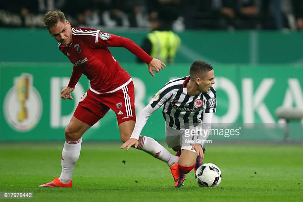 Mijat Gacinovic of Frankfurt is challenged by Max Christiansen of Ingolstadt during the DFB Cup Second Round match between Eintracht Frankfurt and FC...