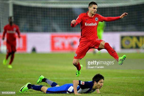 Mijat Gacinovic of Frankfurt jumps over Genki Haraguchi during the Bundesliga match between Hertha BSC and Eintracht Frankfurt at Olympiastadion on...