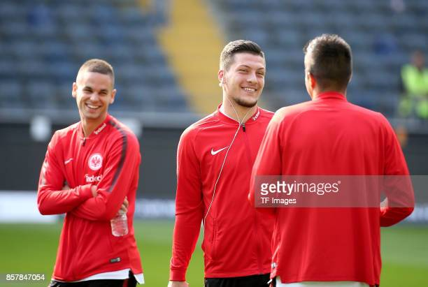 Mijat Gacinovic of Frankfurt speak with Luka Jovic of Frankfurt and Slobodan Medojevic of Frankfurt during the Bundesliga match between Eintracht...