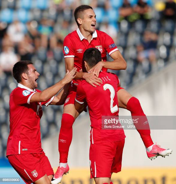 Mijat Gacinovic of Serbia celebrates with team mates after scoring his team's first goal during the UEFA European Under21 Championship match between...