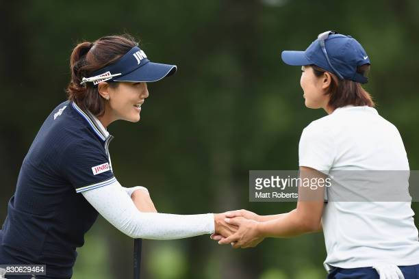 MiJeong Jeon of South Korea and Rumi Yoshiba of Japan shakes hands on the 18th green during the second round of the NEC Karuizawa 72 Golf Tournament...