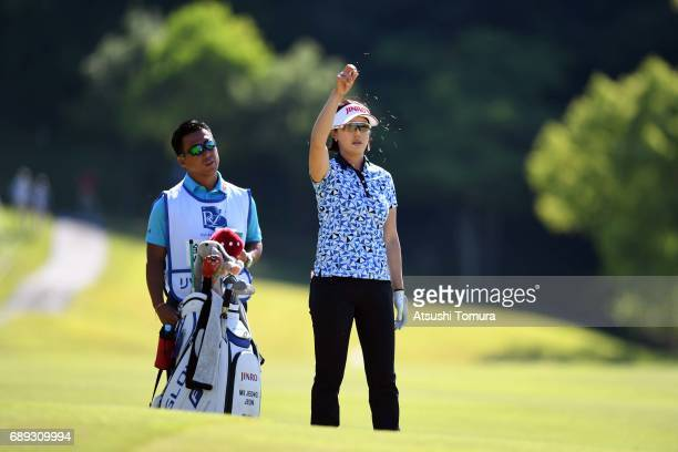 MiJeong Jeon of South Korea checks wind on the 18th hole during the final round of the Resorttrust Ladies at the Oakmont Golf Club on May 28 2017 in...