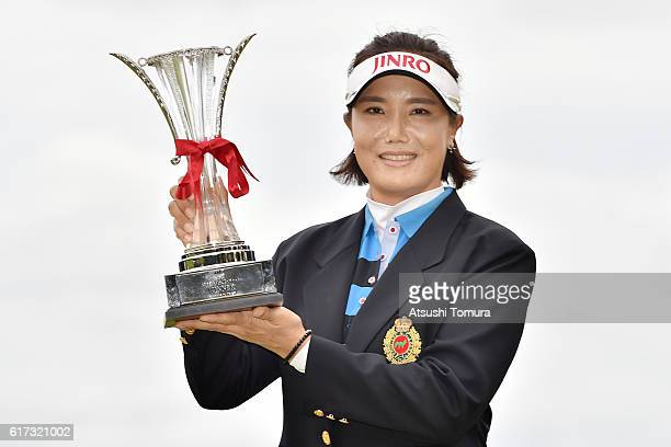 MiJeong Jeon of South Korea poses with the trophy after winning the Nobuta Group Masters GC Ladies at the Masters Golf Club on October 23 2016 in...