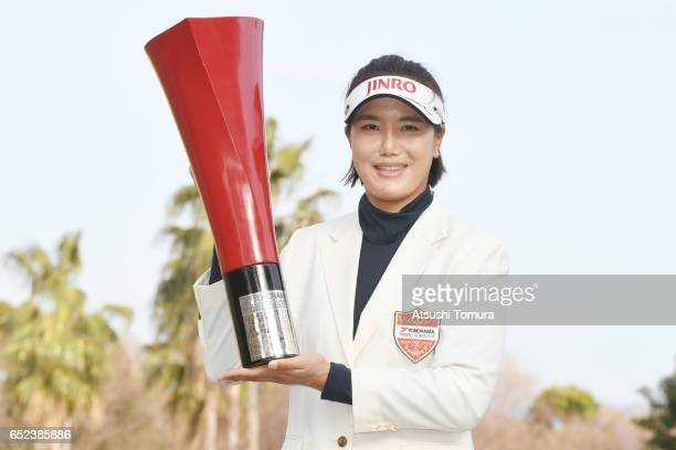 MiJeong Jeon of South Korea poses with the trophy after winning the Yokohama Tire PRGR Ladies Cup at the Tosa Country Club on March 12 Konan Japan